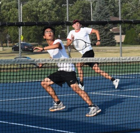 Ethan Park and Louis Wolf, juniors, get in position to return Valparaiso's strategic hit.