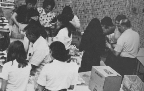 CIRCA 1974 Speech and Debate volunteers from 1974 pack food for the annual chicken barbeque.