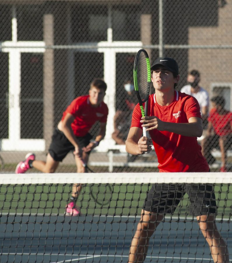 POCH AT THE NET Nick Stephan, junior, anticipates where the serve will return