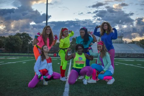 QUEEN FOR A DAY The Homecoming queens, Claire Nowak, Emma Phillips, Megan Flynn, Uyai Edet, Becky Jones, Taylor Graham, and Clara Zuniga, seniors, pose after their 80s day workout. Not pictured queen: Salma Prince
