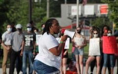 "NO JUSTICE NO PEACE Speaking on a megaphone to a listening crowd, Kayla Prowell, class of '19, recites a poem during the protest that occurred June 5. Kayla also later helped plan a second protest at the town hall. Munster saw a surge of students, graduates and adult support in response to the resurgence of Black Lives Matter this year, paralleling the peaceful protests that have been sparked throughout the nation, ""We're tired of having to do this. We're tired of having to fight for our rights over and over and over again. We fought for them 300 years ago, we fought for them 100 years ago, we fought for them 60 and 50 years ago. We're always fighting, and I think that we're tired of being our own advocates. We're tired of people not being tired of being racist."