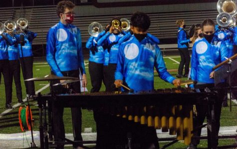 """DETERMINATION Playing the vibraphone in the pit, Shail Patel, freshmen, stays in time requiring major focus. Band has been performing virtually due to COVID-19 regulations, which have restricted their ability to perform inperson. """"The virtual competition was like a real competition because there were still judges that viewed your performance in real time,"""" Shail said, """"But it felt a little more relaxed than a real competition."""""""