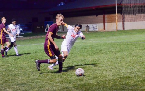 DEFENDING THE GOAL Playing at Goshen High School, Max Marich, senior, defends the goal from Chesterton at regionals..