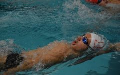 """STAY IN YOUR LANE Victor Vatchev, junior, swimming backstroke during warmups at practice. """"I'm hoping to drop time in my individual events,"""" Vatchev said, """"And try to make State as well as see my teammates succeed."""""""