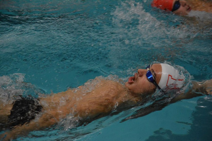 "STAY IN YOUR LANE Victor Vatchev, junior, swimming backstroke during warmups at practice. ""I'm hoping to drop time in my individual events,"" Vatchev said, ""And try to make State as well as see my teammates succeed."""