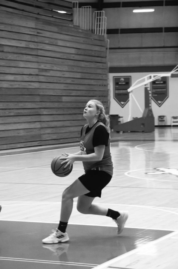 """PRACTICE MAKES PERFECT At their practice on Nov. 10, Nikki Sullivan, junior, runs drills with her teammates. The team hopes to go even farther than last year. """"On top of that, (I hope)  to strengthen the 'family' culture that we started last year,"""" she said."""