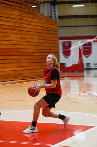 "PRACTICE MAKES PERFECT At their practice on Nov. 10, Nikki Sullivan, junior, runs drills with her teammates. The team hopes to go even farther than last year. ""On top of that, (I hope)  to strengthen the 'family' culture that we started last year,"" she said."