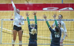 """SPIKE IT At the state meet at Ball State university, Haley Melby,  junior, spikes the ball over the net. """"We never stopped fighting and we made a name for ourselves in the state,"""" Haley Melby, junior, said.  """"We proved that we belonged and that we are a big threat."""""""