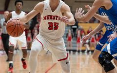 """OFF THE COURT Last basketball season, current senior, Luka Balac, makes a move against a Lake Central defender. Now, Boys' Basketball has been suspended, and practices have dramatically changed. """"(Before), we've been practicing our defense,"""