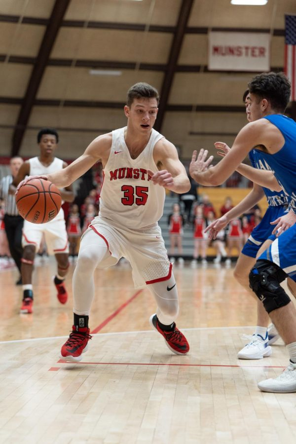 "OFF THE COURT Last basketball season, current senior, Luka Balac, makes a move against a Lake Central defender. Now, Boys' Basketball has been suspended, and practices have dramatically changed. ""(Before), we've been practicing our defense,"
