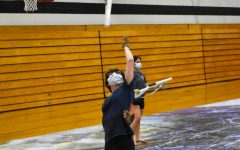 IN ACTION As Winter Guard enters an early season, Abbey Gorny, senior, tosses her rifle, preparing to catch it behind her back.