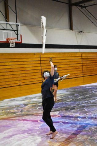 IN ACTION As Winter Guard enters an early season, Abbey Gorny, senior, tosses her rifle, preparing to catch it behind her back. I am personally very excited for this season; it seems like our most challenging and powerful yet, Abbey said.