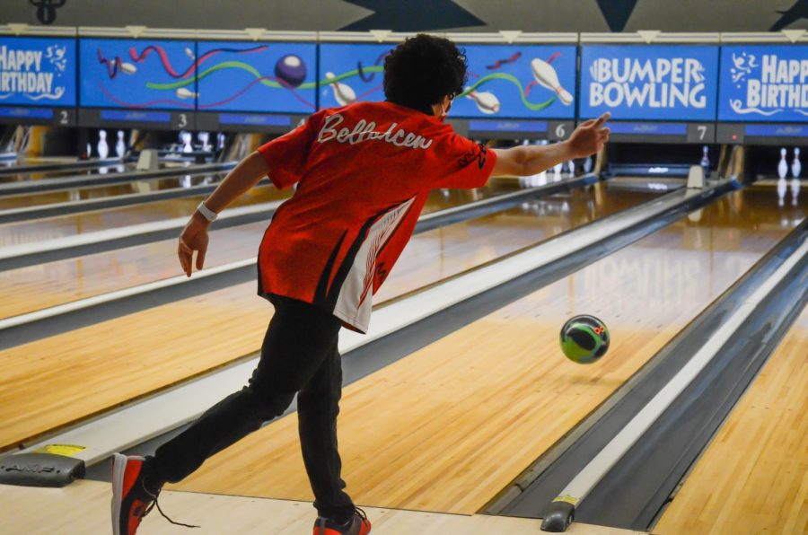 KNOCK'EM DOWN: Anthony Bellahcen, sophomore, throws the bowling ball down the alley at the teams practice on Nov. 22.