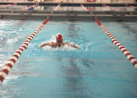 "SWIMMING IN FIRST Competing in the 200m Individual medley, Hannah Robbins, junior, takes first at the NCC conference championship. ""Our goals for the rest of the season are to win sectionals as a team,"" Robbins said. ""I also want to win the 200 Individual medley and make it to state."""