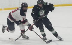 GLIDING ON ICE At the Kube Sports Complex freshman, Joey Campagna, freshman, races for the puck in a scrimage game against the Spartans.