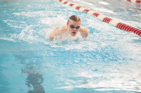 STRIVING FOR THE STREAK At swim practice Jordan Spilde, sophomore, prepares for the upcoming sectional and state meet practicing the butterfly stroke. The boys team has high hopes to keep their thirty five going on thirty six year streak at sectionals.