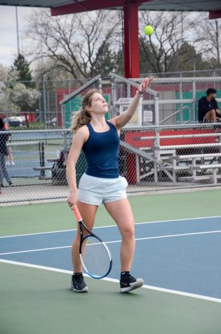"GET SERVED Serving the ball in her practice match, Addy Klawitter, senior, prepares for the season. ""It"