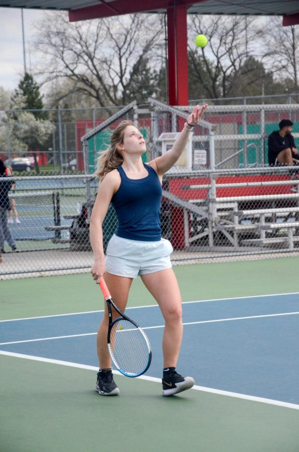 "GET SERVED Serving the ball in her practice match, Addy Klawitter, senior, prepares for the season. ""It's mainly matches,"