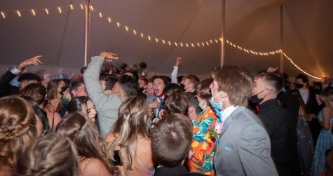 Seniors dance in the outdoor tent provided at prom night.