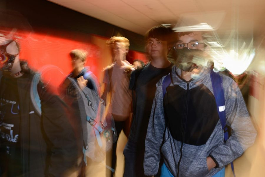 BLURRED LINES Stampeding into the hallway, students rush out of their classrooms after being dismissed to MRT.  At the start of the year, students often were lost without having previous years of experience.