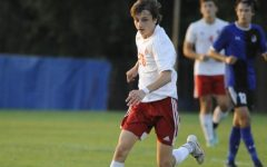 """LOOKING FOR AN OPENING Matt Benard, junior, dribbles the ball looking for an open teammate on the field during their game against Lake Central. When asked about his goals for this season, Matt states, """"My goals are to get better individually and as a team, and hopefully try to win State."""""""