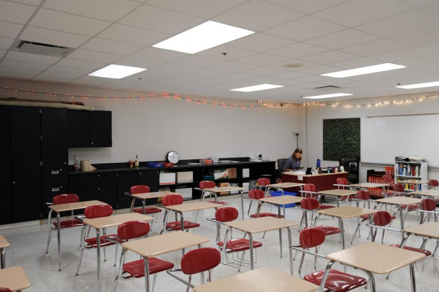 """READ THE ROOM Sitting in his newly renovated classroom, Mr. Steve Stepnoski, English teacher, works after the last school bell. """"I think that (the room) is just going to be reflective of the school year,"""" Mr. Steve Stepnoski, English teacher said. It was a blank canvas at the beginning of the school year, and just like the school year changes, my classroom will change and itll adapt and gain its personality."""