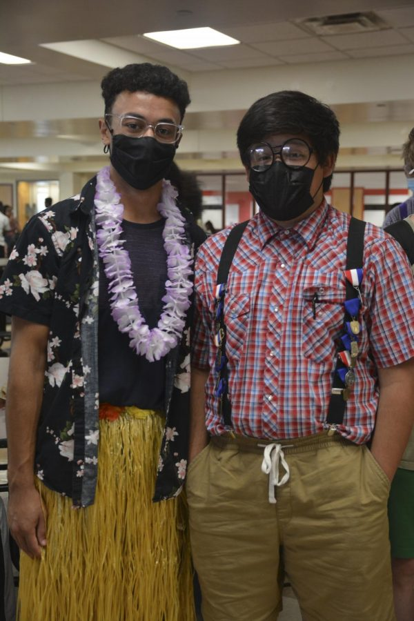 ROAD TO HOCO Corey Dennis, junior, is dressed up for tropical day and Antonio Cantu, senior, is dressed up for nerd day.
