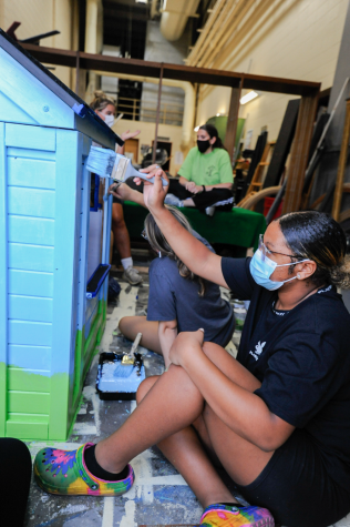 """PAINT, PAINT, PAINT Working on the senior CEC house, Laila Mosley, senior, puts on the first coat of paint for the blue sky. """"The house is really coming together and it's so fun to make,"""" Laila said. """"I feel like it reflects our colorful personalities."""