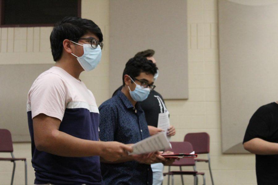 SINGING A NEW TUNE During a SING rehearsal, Adan Porras, senior, sings alongside his classmates.